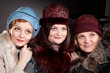 Three women mother and daughters  wearing felt hats