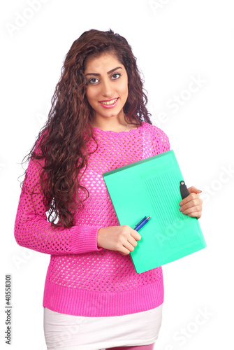 Pretty student holding notes and pen