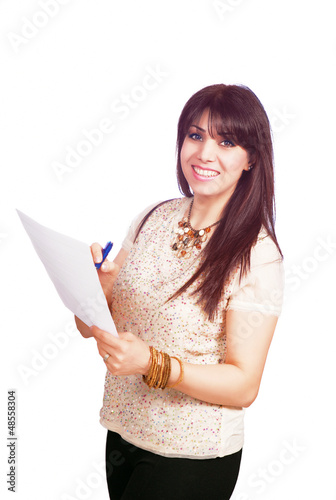 Smiling supervisor writing inspection notes