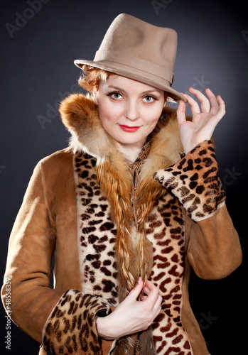 Attractive  redhaired curly    woman wearing  felt hat