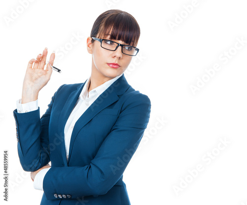 Successful businesswoman with spectacles looking sideways