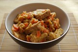 Stew tempeh with carrots and onion