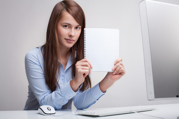 Young woman Holding Blank Paper