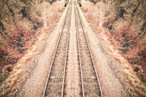 HDR abstract of autumnal railroad tracks