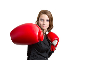 Business woman with a boxing glove