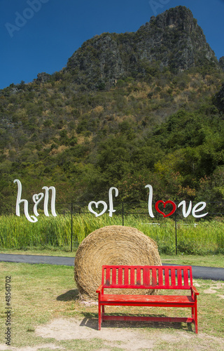 red bench in the hill of love