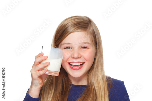 girl with a glass of milk and milk moustache smiling