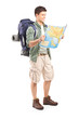 Full length portrait of male hiker looking at map