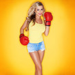 Beautiful Blonde Woman Wearing Boxing Gloves