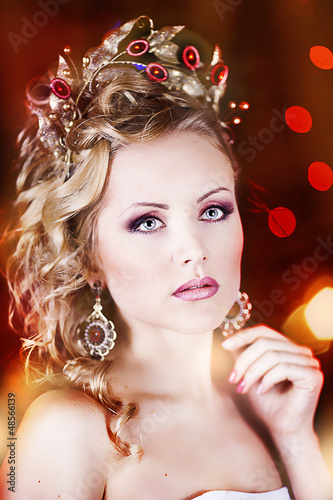 fashion portrait of a beautiful girl with crown