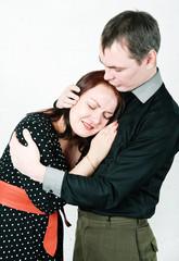 Man comforting his crying woman