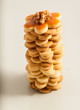 Tower of homemade butter cookies with caramel and nut, top view