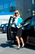 business woman exit her car