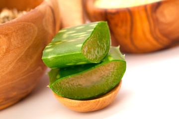 aloe vera fresh leaf on wooden spoon