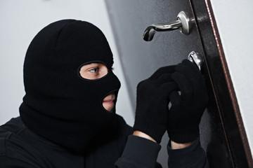 burglar thief at house breaking
