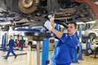Leinwandbild Motiv auto mechanic at car suspension repair work