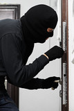 burglar thief at house breaking