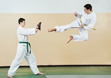 Two man at taekwondo exercises