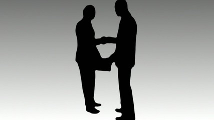 Two business men shaking hands.