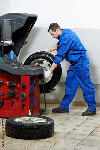 repairman mechanic at wheel balancing