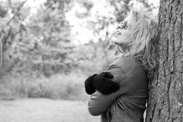 BW - Blonde woman at the woods, laughing