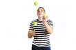 man juggling tennis ball