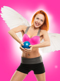 Beautiful sensual angel doing fitness