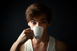 man drinking coffee on dark  background