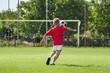 boy kicking footbal