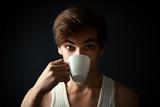 man drinking coffee on dark  background