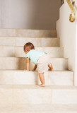 Little girl climbing steps at home
