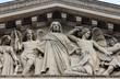 """The sculpted tympanum of the church """"La Madeleine"""", Paris"""