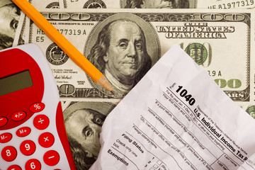 Tax Form, Calculator, Money and Pencil
