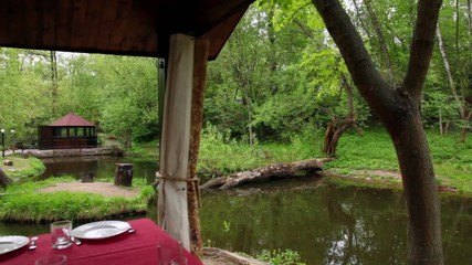 Table is set in summerhouses ashore of small pond
