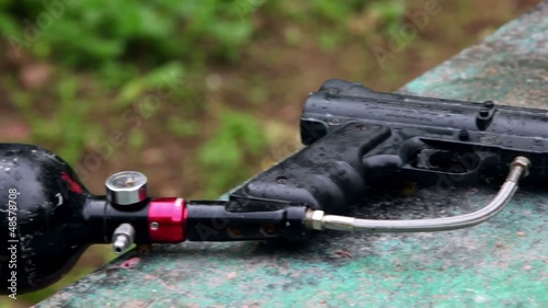 Rain drops fall down on paintball gun