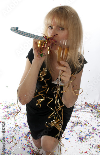 Woman celebrating champagne  New Year's Eve noise maker