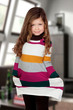 Shy girl with colorful dress