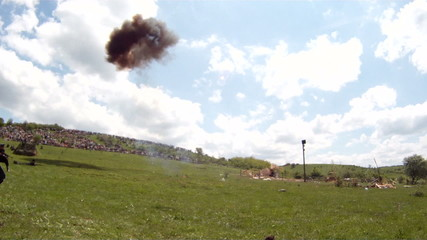 Bombardment of the battlefield during a reenactment of a battle