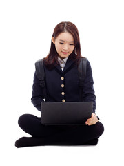 Yong pretty Asian student studying whit laptop