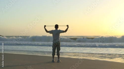 Man doing exercises on a beach
