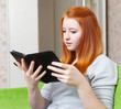 Teenager girl reads e-reader