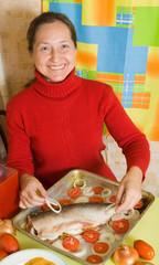Woman cooking  salmon fish