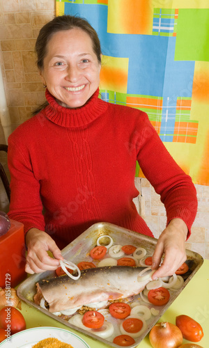 Woman cooking  salmon fish