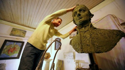 Sculptor use clay to correct unfinished A.Suvorov bust