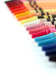Beautiful colorful pastel(crayon) pencils in a row(line) on whit