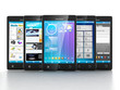 Mobile applications. Group of mobile phones are frontally on a w