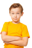 Puzzled boy in yellow t-shirt