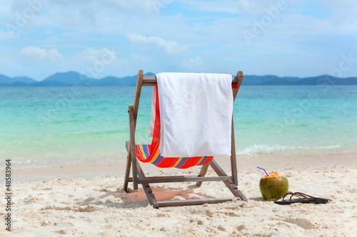 Empty Beach chair on tropical summer beach