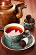Tea and chocolate candies in a vintage style