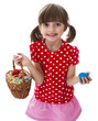 little girl holding basket with easter eggs